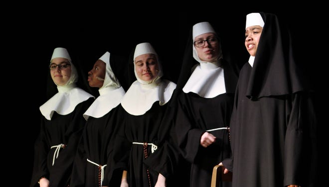 """Four other nuns (from left, Lauren Epps, Aubri Cruse, Blakely Millspas and Cherith Lisenbee) consider a """"sister"""" putting on an act (Nalani Abdullah, right) in this rehearsal scene from """"Sister Act,"""" Cooper High School's winter musical."""