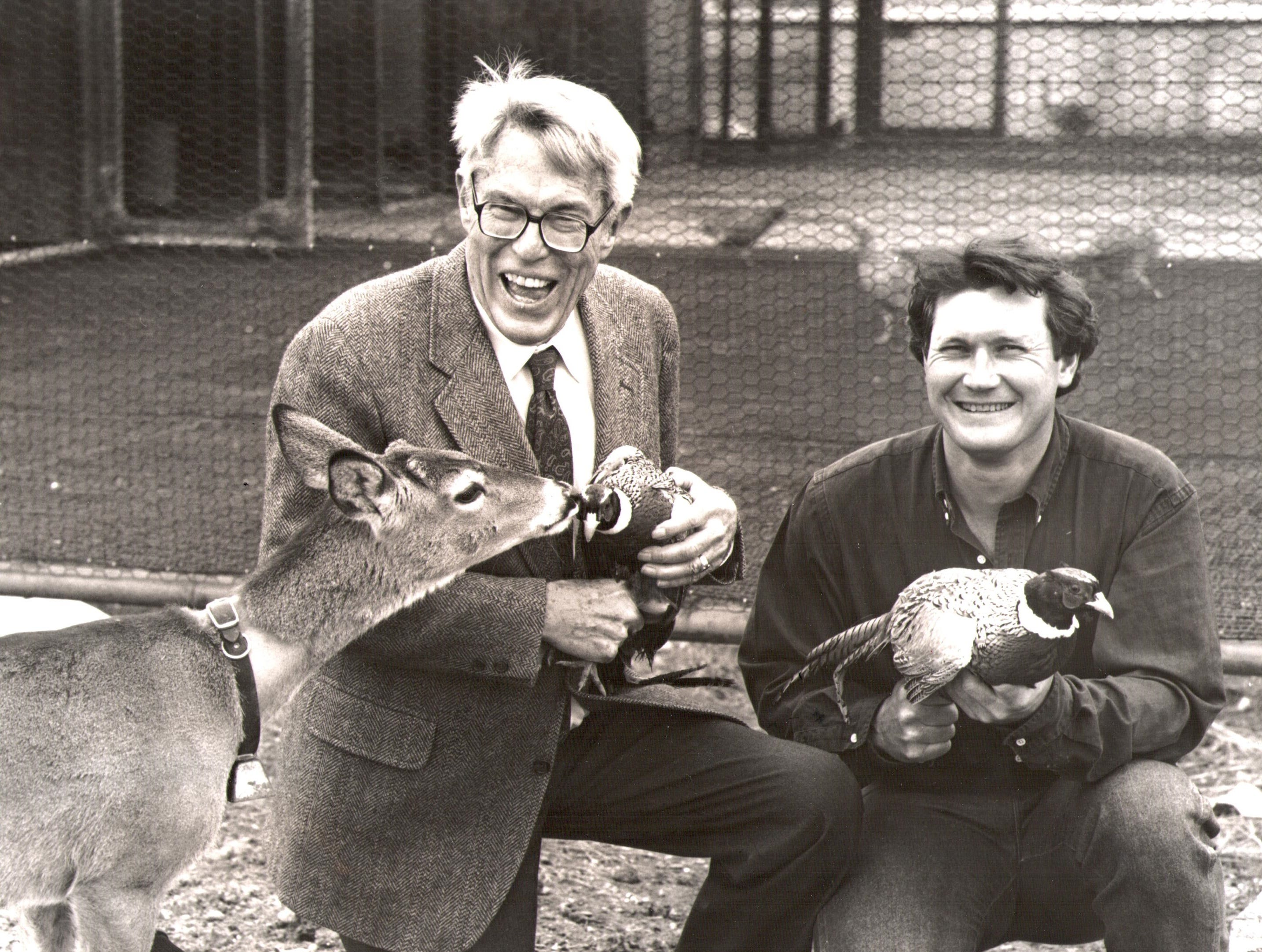 Bill Terry (left) a member of the Celebrity Quail Hunt steering committee, and Dr. Norman Dozier, president of the Big Country Game Bird Farm, hold a couple of birds at the farm in 1991.