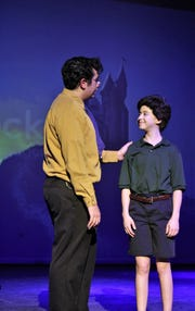 "Edward Bloom (Spencer Kasselman) talks with his son Will (Carlee Lamb) in this rehearsal scene from ""Big Fish,"" this winter's musical at Abilene High School."