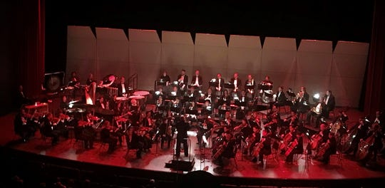 "Under red lighting, the Abilene Philharmonic performed ""Symphony No. 5"" by Dmitri Shostakovich on Saturday evening, Jan. 26."