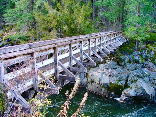 Crossing a Rogue River bridge, Oregon