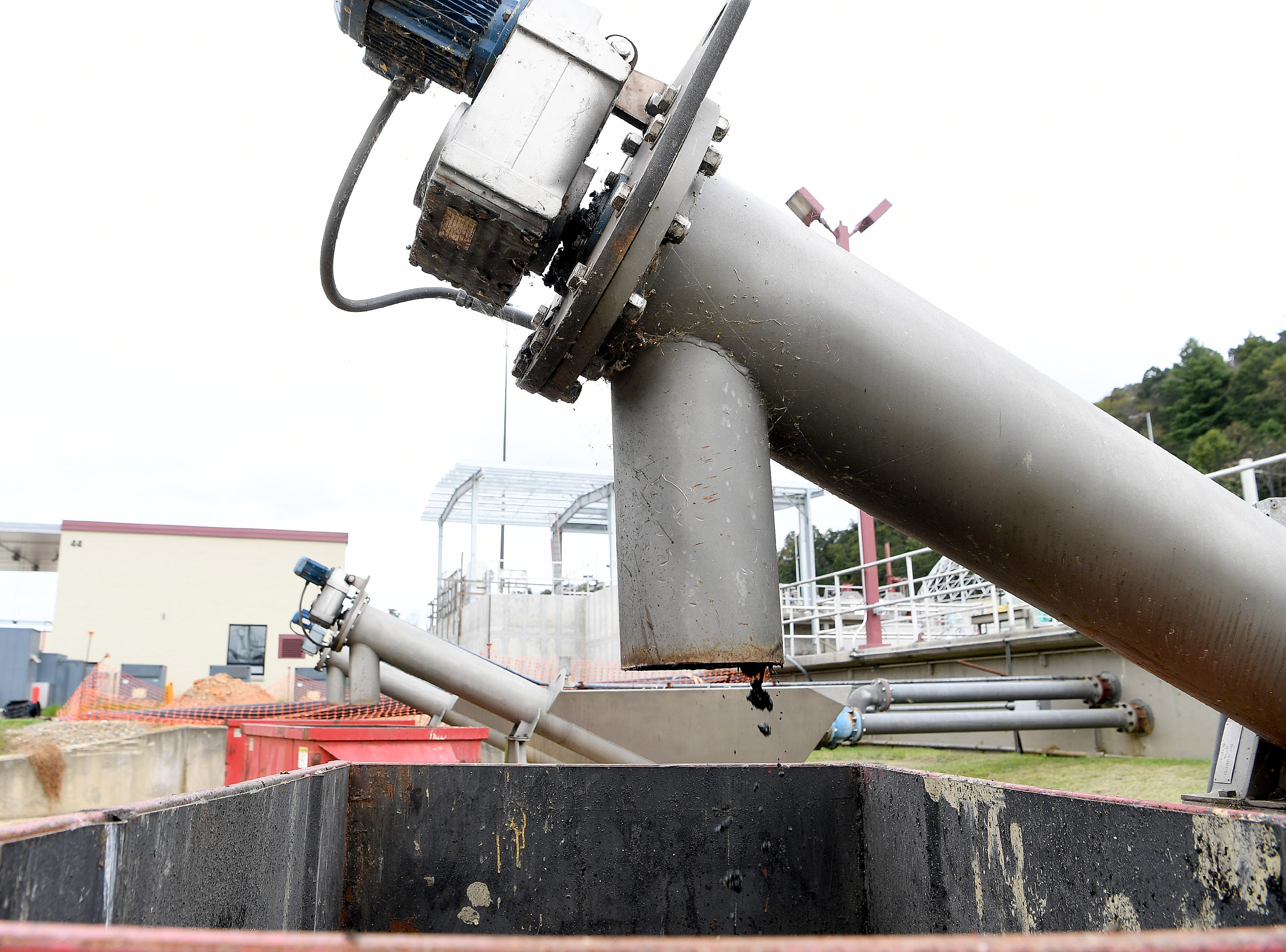 Solids are removed from sewage arriving at the Metropolitan Sewerage District's water reclamation facility beginning the treatment process on Oct. 9, 2018.