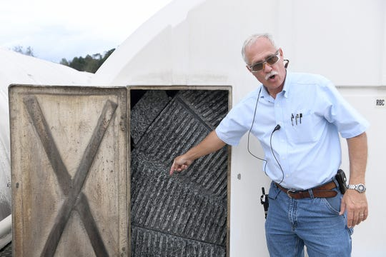 Roger Edwards, Wastewater Reclamation Facility Operations Manager, talks about the rotating biological contactors as a step in the process of treating Asheville's wastewater at the water reclamation facility of the Metropolitan Sewerage District on Oct. 9, 2018. The facility has 152 rotating biological contactors.