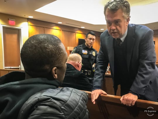Buncombe County District Attorney Todd Williams speaks with Johnnie Rush in early 2019.