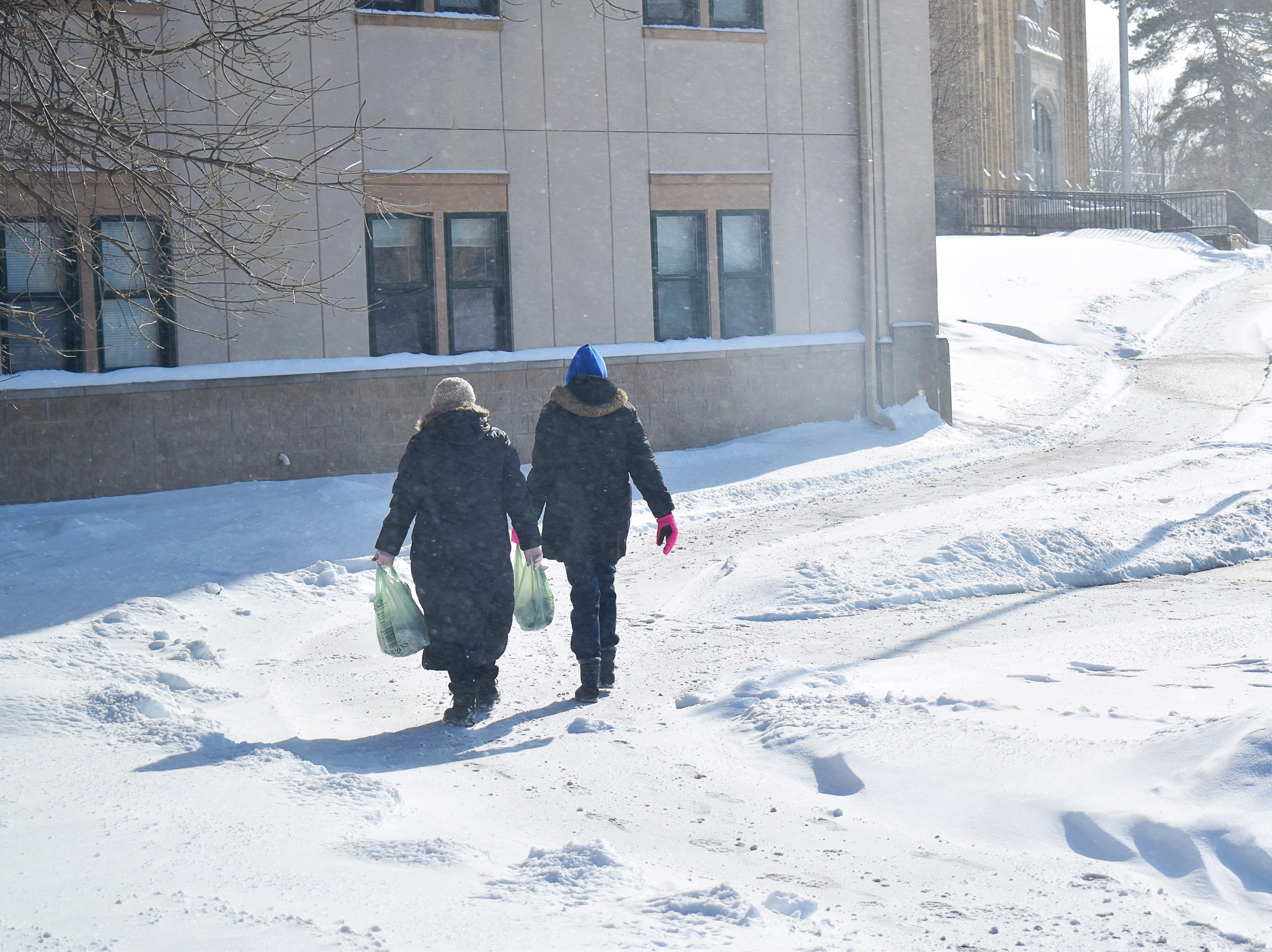 Jessica Eldridge and Natasha Northcutt of Battle Creek Montessori delivered meals to students on Tuesday.