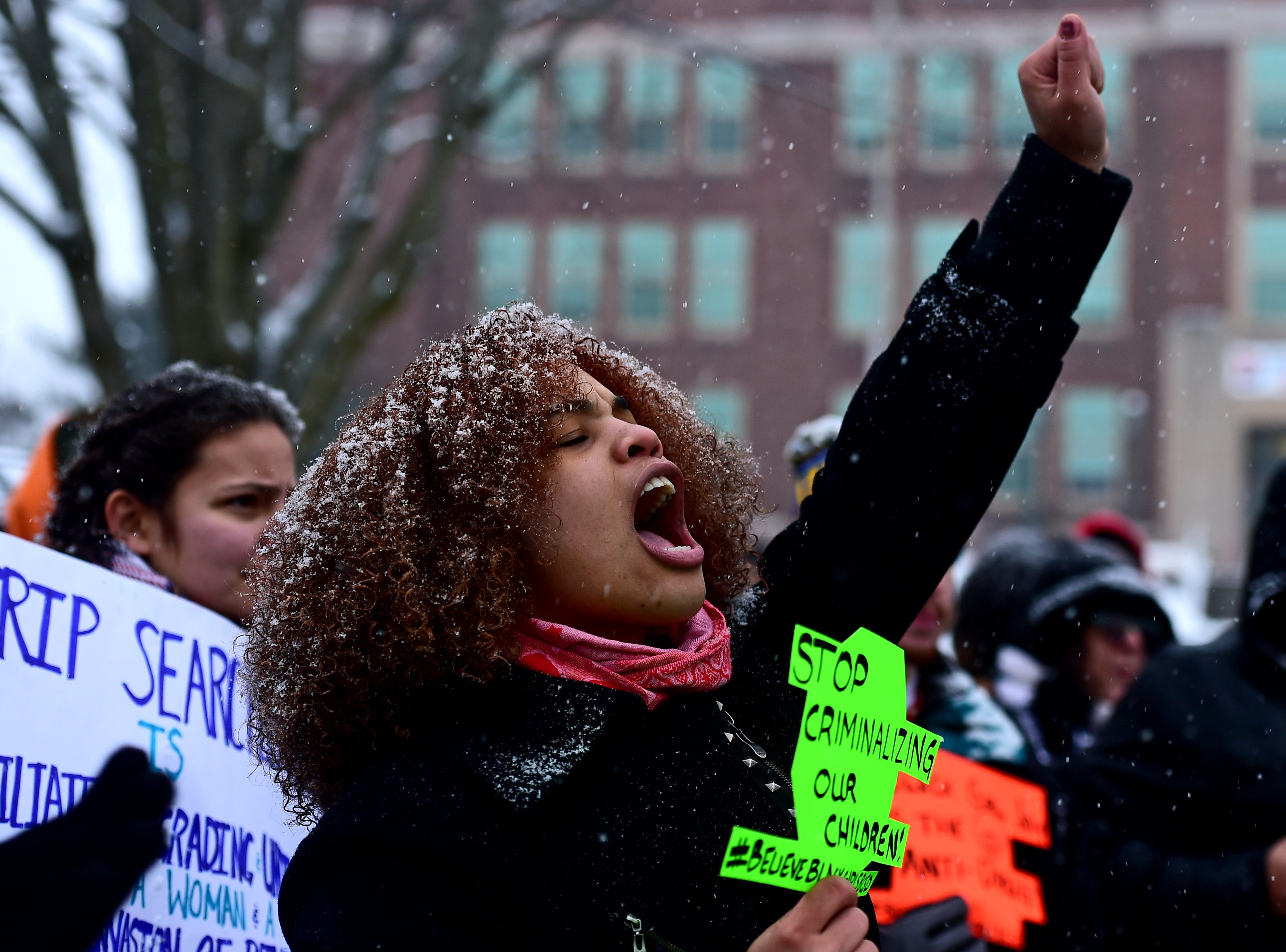Community members, activists and members of Progressive Leaders Of Tomorrow rally Tuesday in front of East Middle School in Binghamton to protest the recent alleged strip searches of four female students.