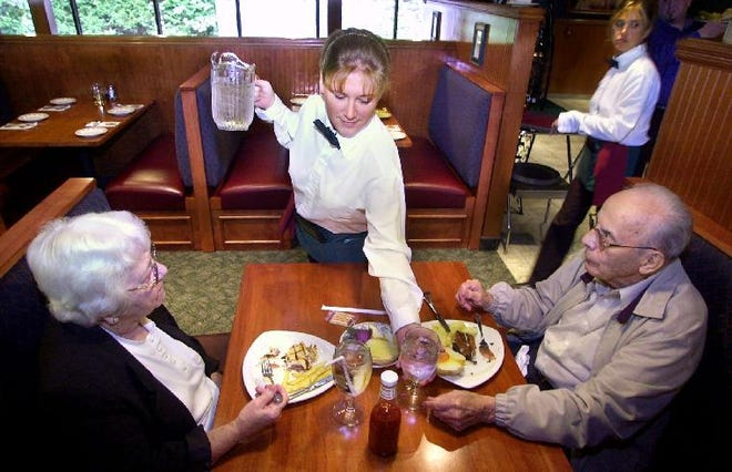In 2001, waitress Laurie Mott serves Fred and Louise Millen of Endwell during lunch at the re-open Nirchi's on the Avenue in Endicott.