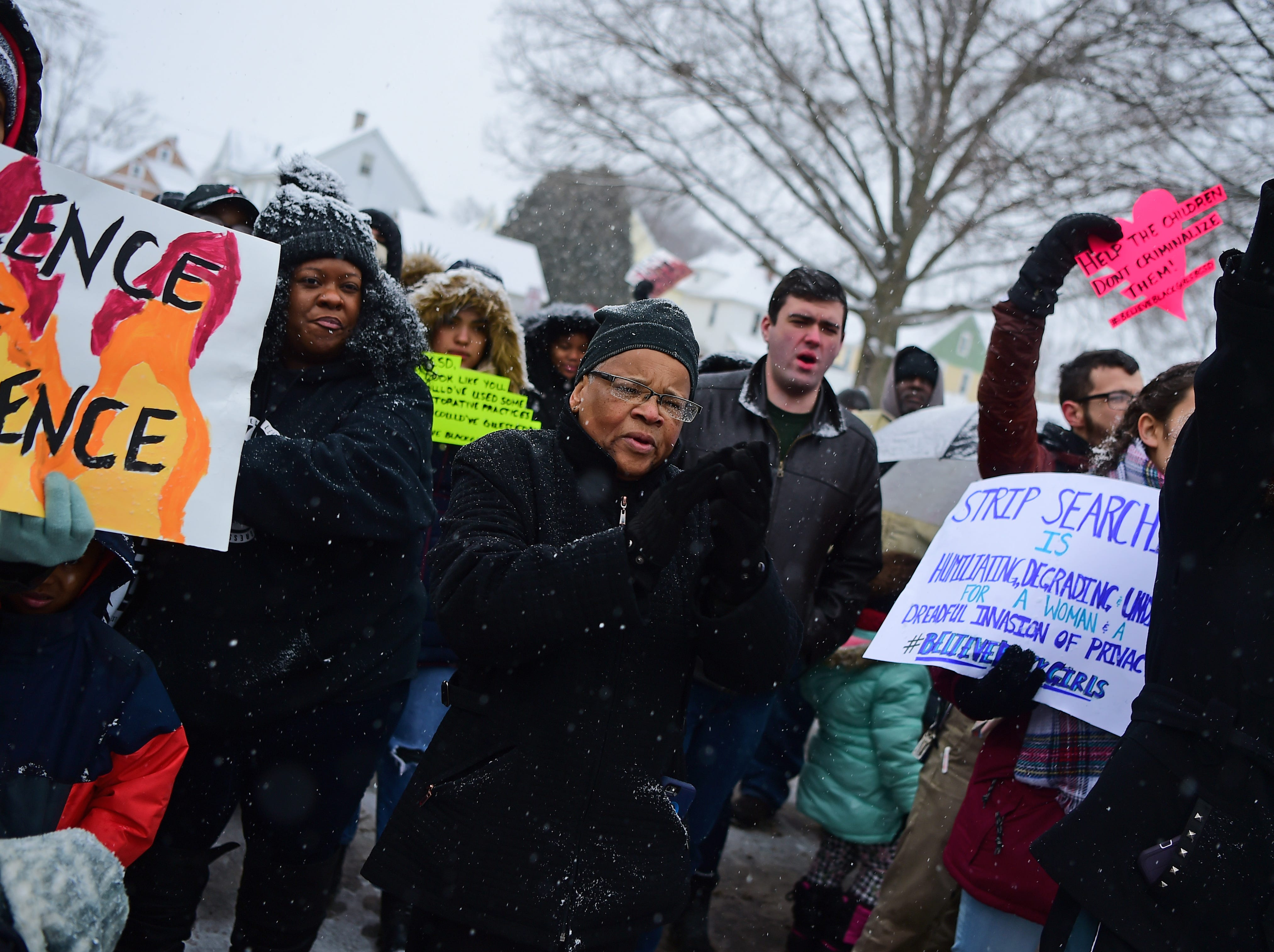 Community members, activists and members of Progressive Leaders Of Tomorrow (PLOT) rally in front of East Middle School in Binghamton to protest the recent alleged strip search of four female students. Tuesday, January 29, 2019.