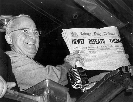 "President Harry S. Truman holds up an election day edition of the Chicago Daily Tribune, which mistakenly announced ""Dewey Defeats Truman"" on Nov. 4, 1948."