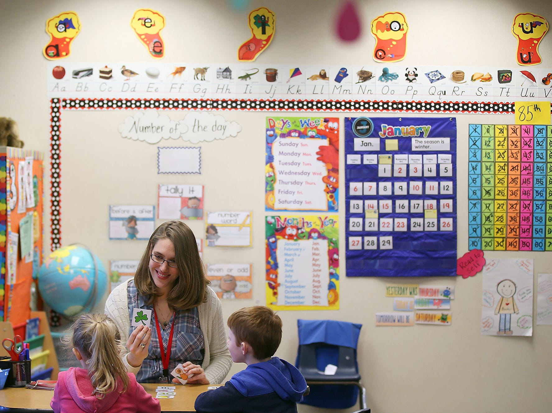 Poulsbo Elementary School teacher Anna Johnston works with students during class on Tuesday, January 29, 2019.