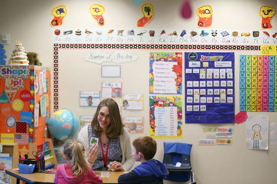Poulsbo Elementary kindergarten teacher Anna Johnston works with students during class.