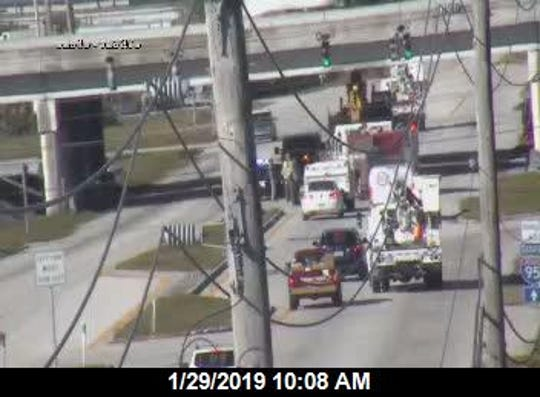 A utility truck became stuck under the Interstate 95 overpass on Eau Gallie Boulevard Tuesday.