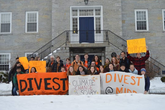 Members of the student group Divest Middlebury, pictured outside the college's administrative building Old Chapel on Saturday, Jan. 26.