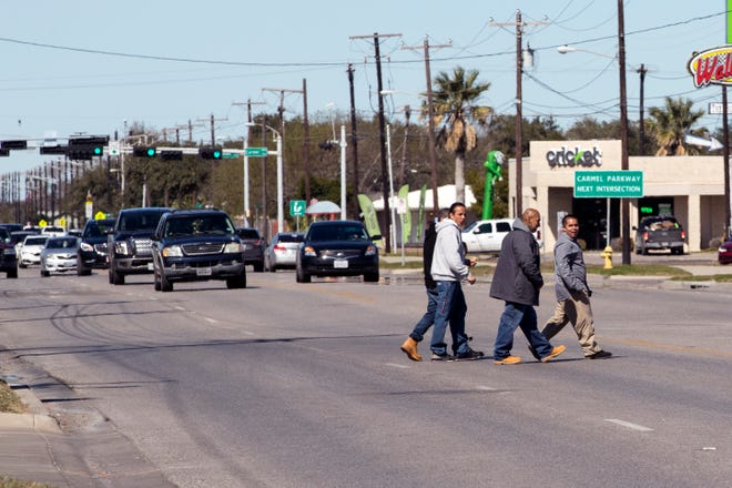 Men cross in the middle of the street in the 4100 block of South Staples Street on Jan. 29, 2019. Statistics from the Corpus Christi Police Department show that a high number of auto-pedestrian accidents take place between the blocks of 4000 and 4200 South Staples Street.
