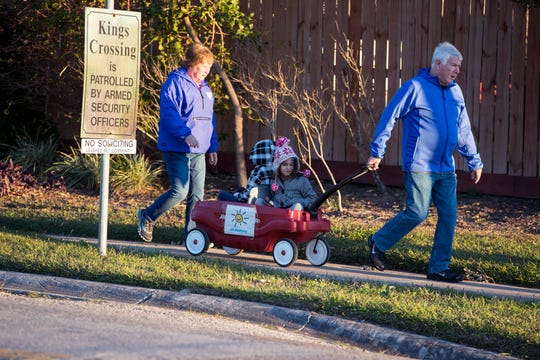 A family walks to Mireles Elementary School on Tuesday, January 29, 2019. An arctic cold front is moving into the Coastal Bend and into the Gulf waters, according to a forecast from the National Weather Service in Corpus Christi. Lows will dip to the 40s with wind gusts as high as 39 mph.