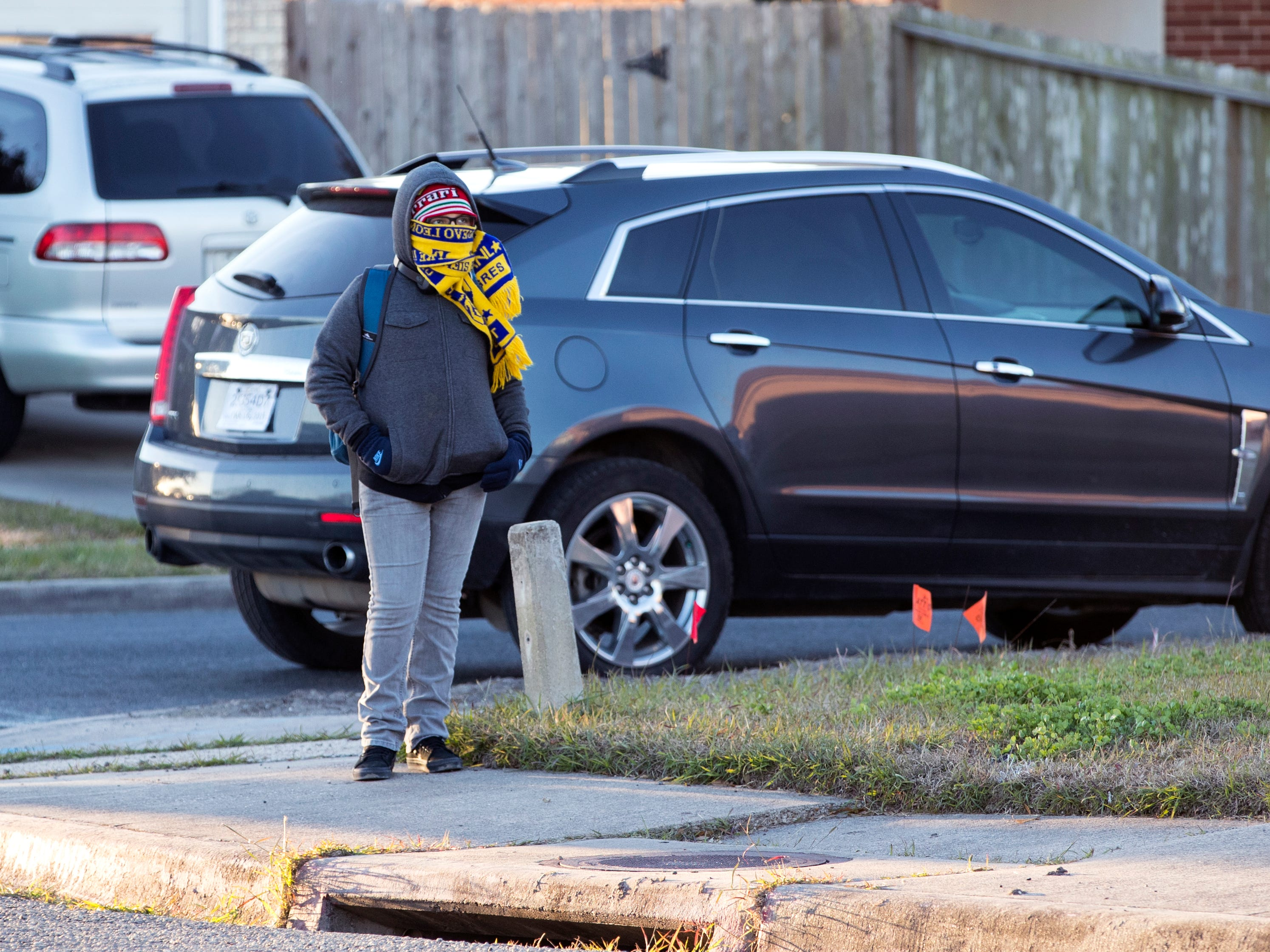 A student waits for a bus outside Mireles Elementary School on Tuesday, January 29, 2019. An arctic cold front is moving into the Coastal Bend and into the Gulf waters, according to a forecast from the National Weather Service in Corpus Christi. Lows will dip to the 40s with wind gusts as high as 39 mph.