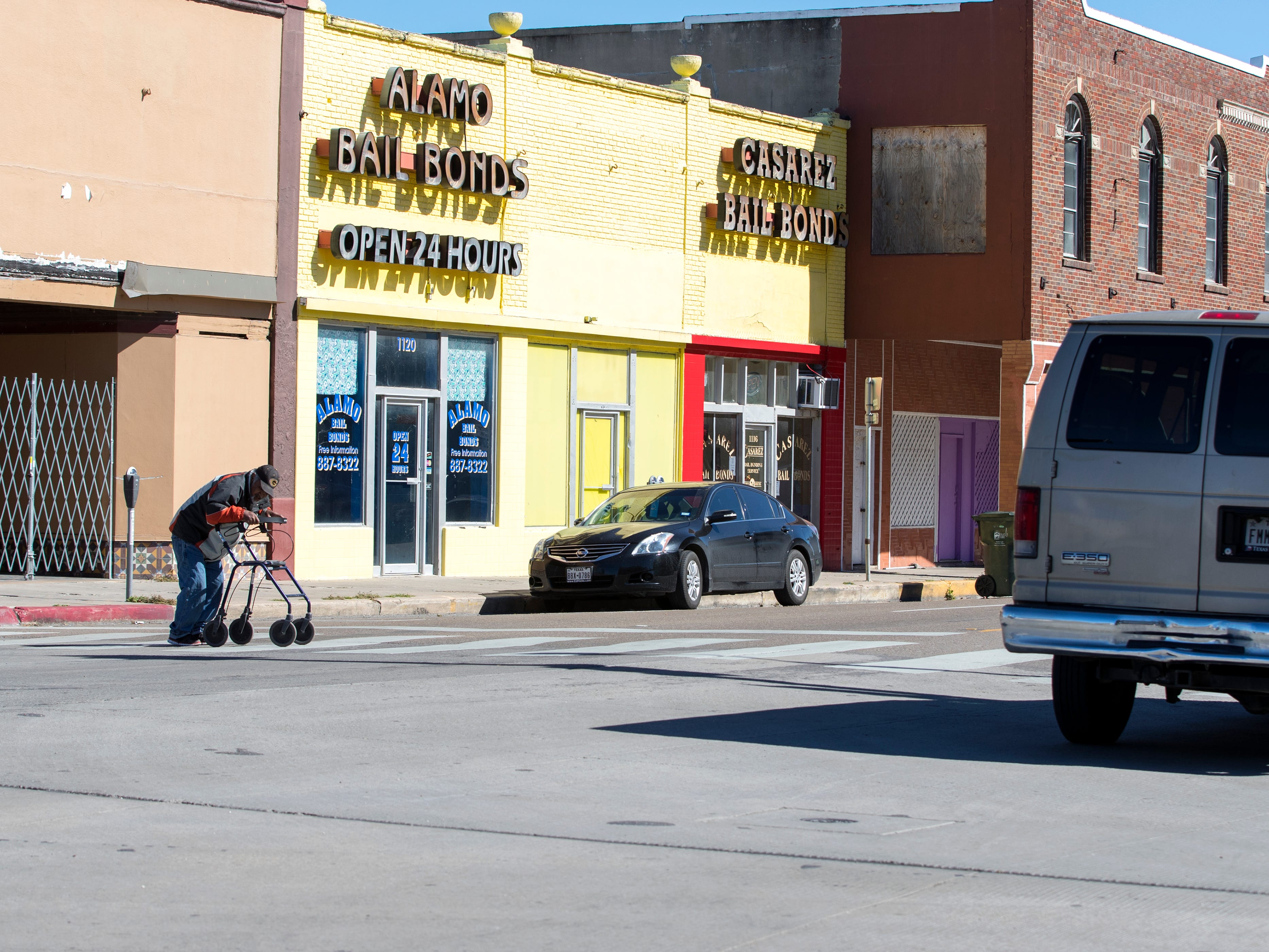 A man crosses in a crosswalk against the light in the 1100 block of Leopard Street on Tuesday, January 29, 2019. Statistics from the Corpus Christi Police Department show that a high number of auto-pedestrian accidents take place in the 1100 block of Leopard Street.