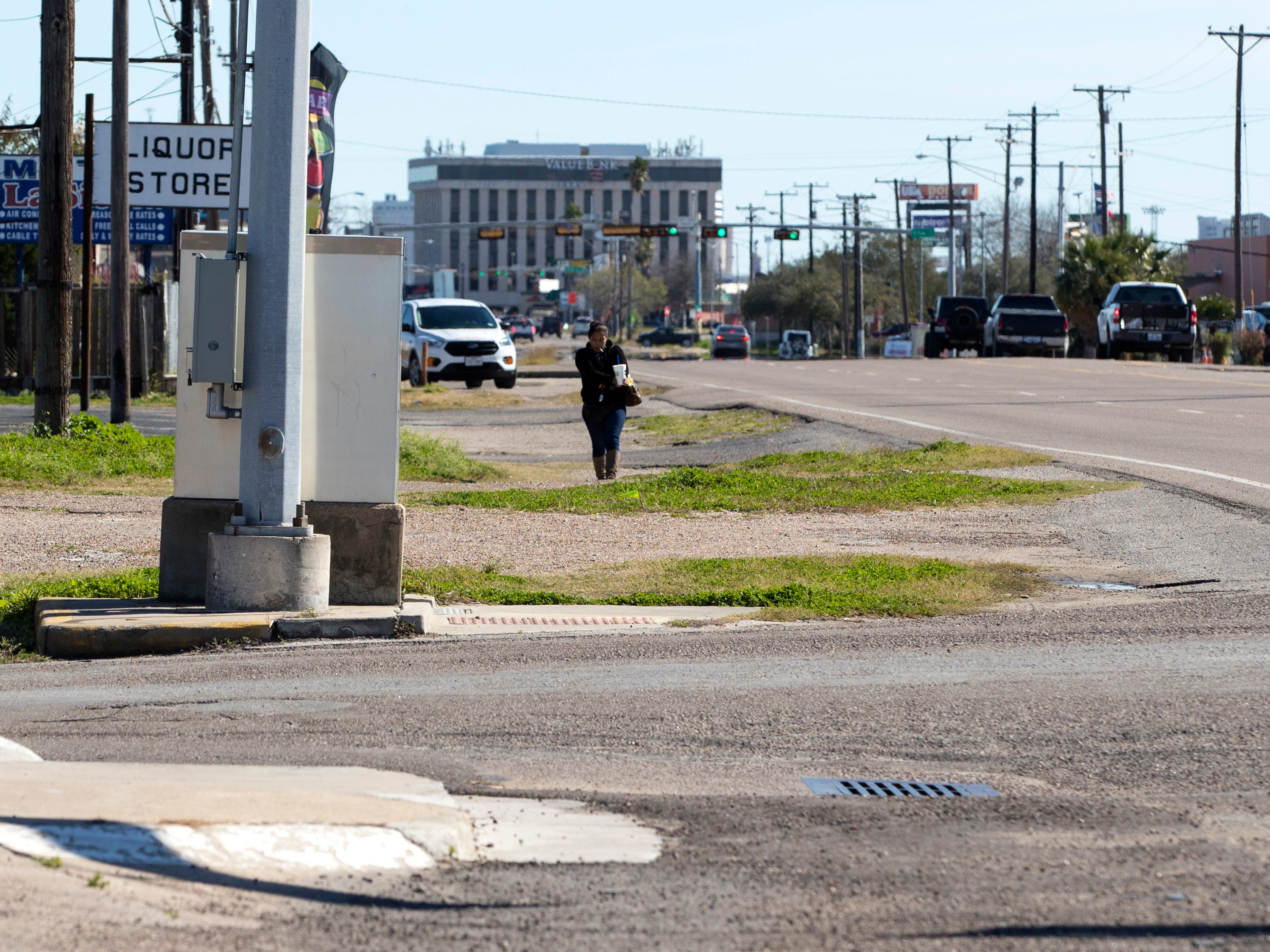 A woman walks along Leopard Street on Tuesday, January 29, 2019. Statistics from the Corpus Christi Police Department show that a high number of auto-pedestrian accidents take place in the 4500 block of Leopard Street.