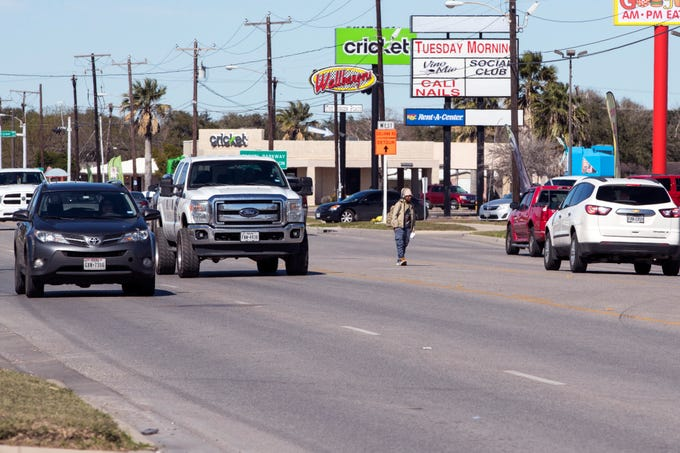 A man crosses in the middle of the street in the 4100 block of South Staples Street on Jan. 29, 2019. Statistics from the Corpus Christi Police Department show that a high number of auto-pedestrian accidents take place between the blocks of 4000 and 4200 South Staples Street.