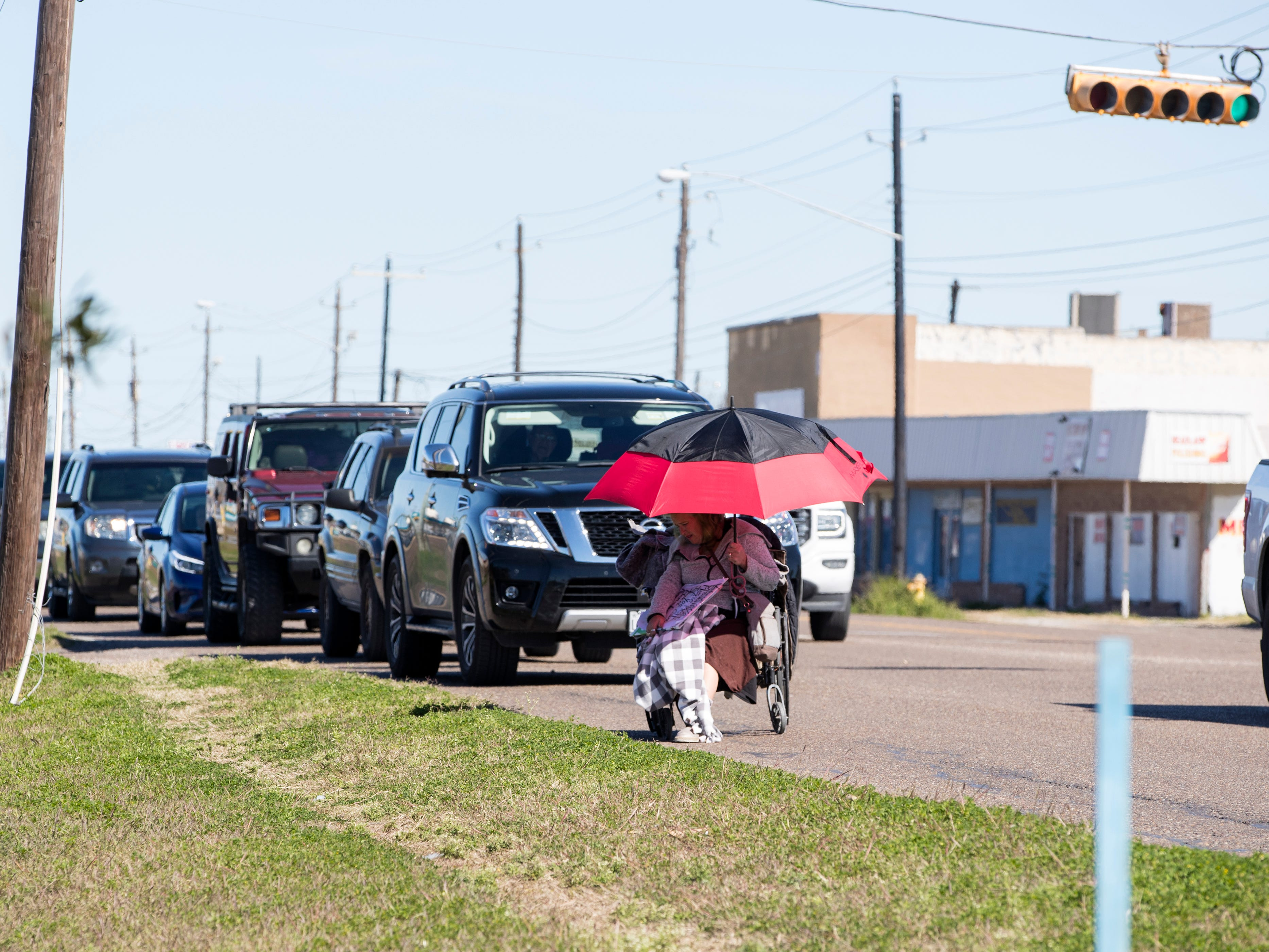 A woman in a wheelchair travels in the 4900 block of Ayers Street on Tuesday, Jan. 29, 2019. Statistics from the Corpus Christi Police Department show that a high number of auto-pedestrian accidents take place between the blocks of 4100 and 4900 Ayers Street.