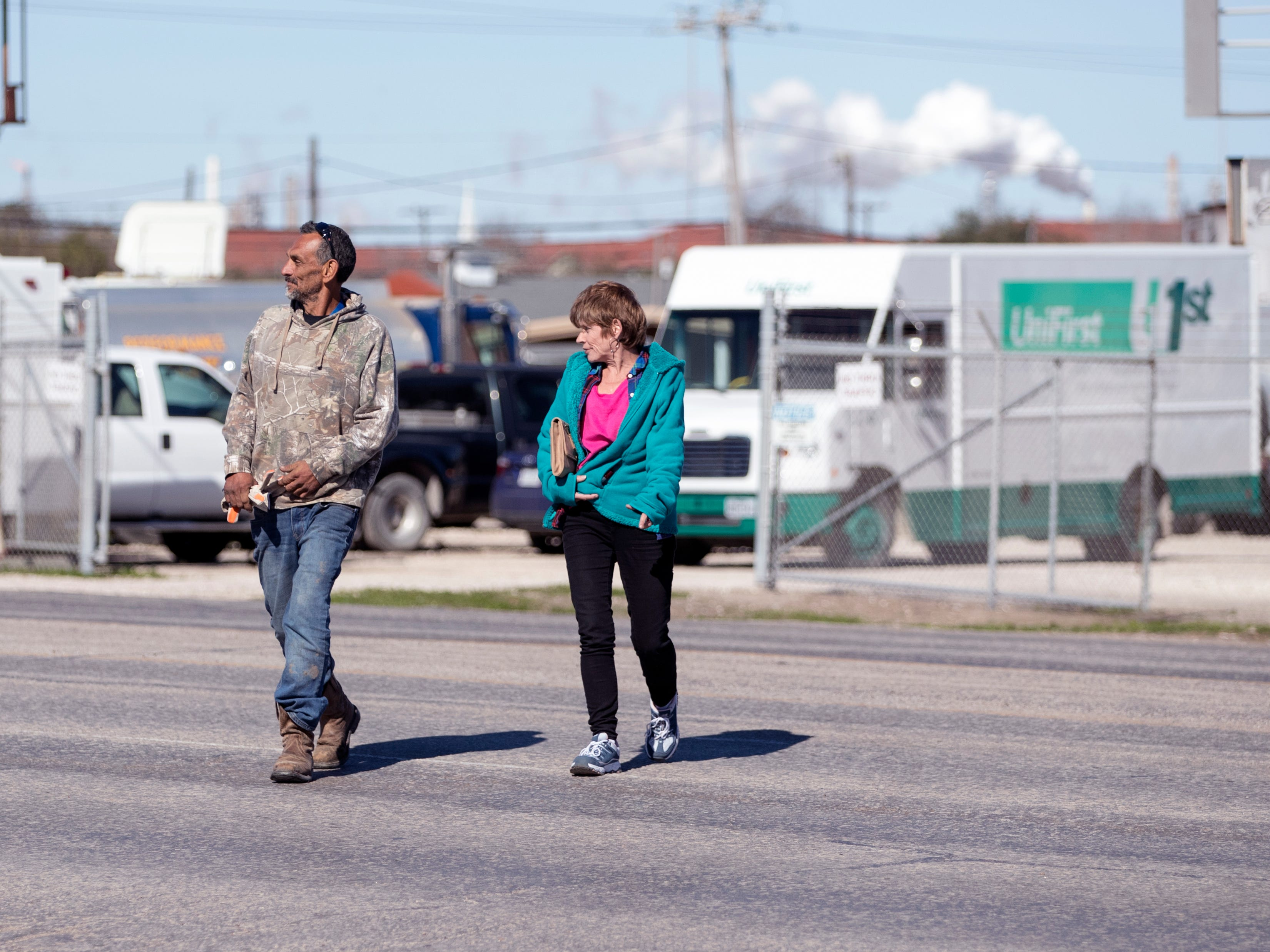People cross the street without using a crosswalk in the 5400 block of Leopard Street on Tuesday, Jan. 29, 2019. Statistics from the Corpus Christi Police Department show that a high number of auto-pedestrian accidents take place in the 5400 block of Leopard Street.