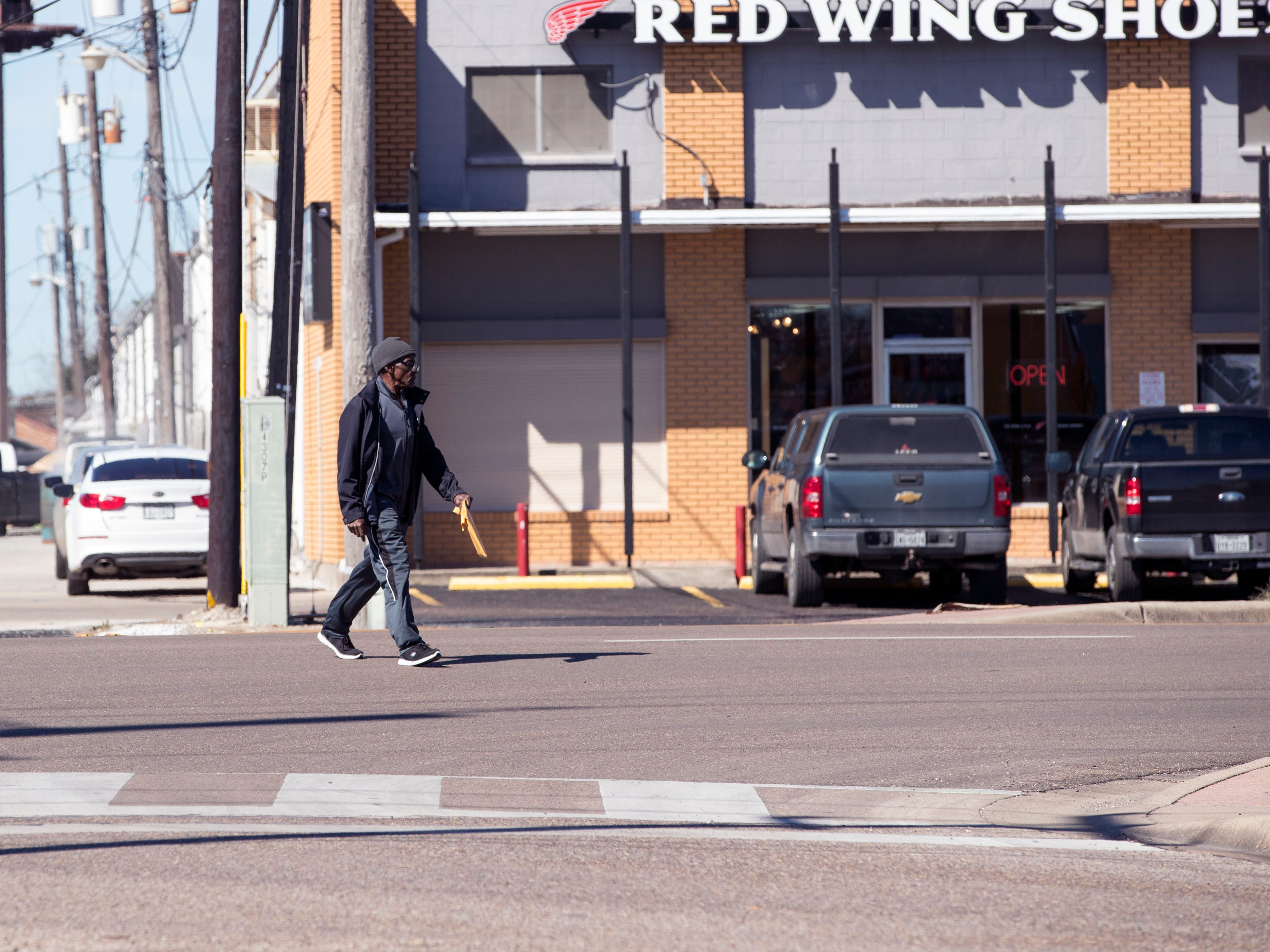 A man crosses in the middle of the street near the Ayers Street Station for the RTA on January 29, 2019. Statistics from the Corpus Christi Police Department show that a high number of auto-pedestrian accidents take place between the blocks of 4100 to 4900 Ayers Street.