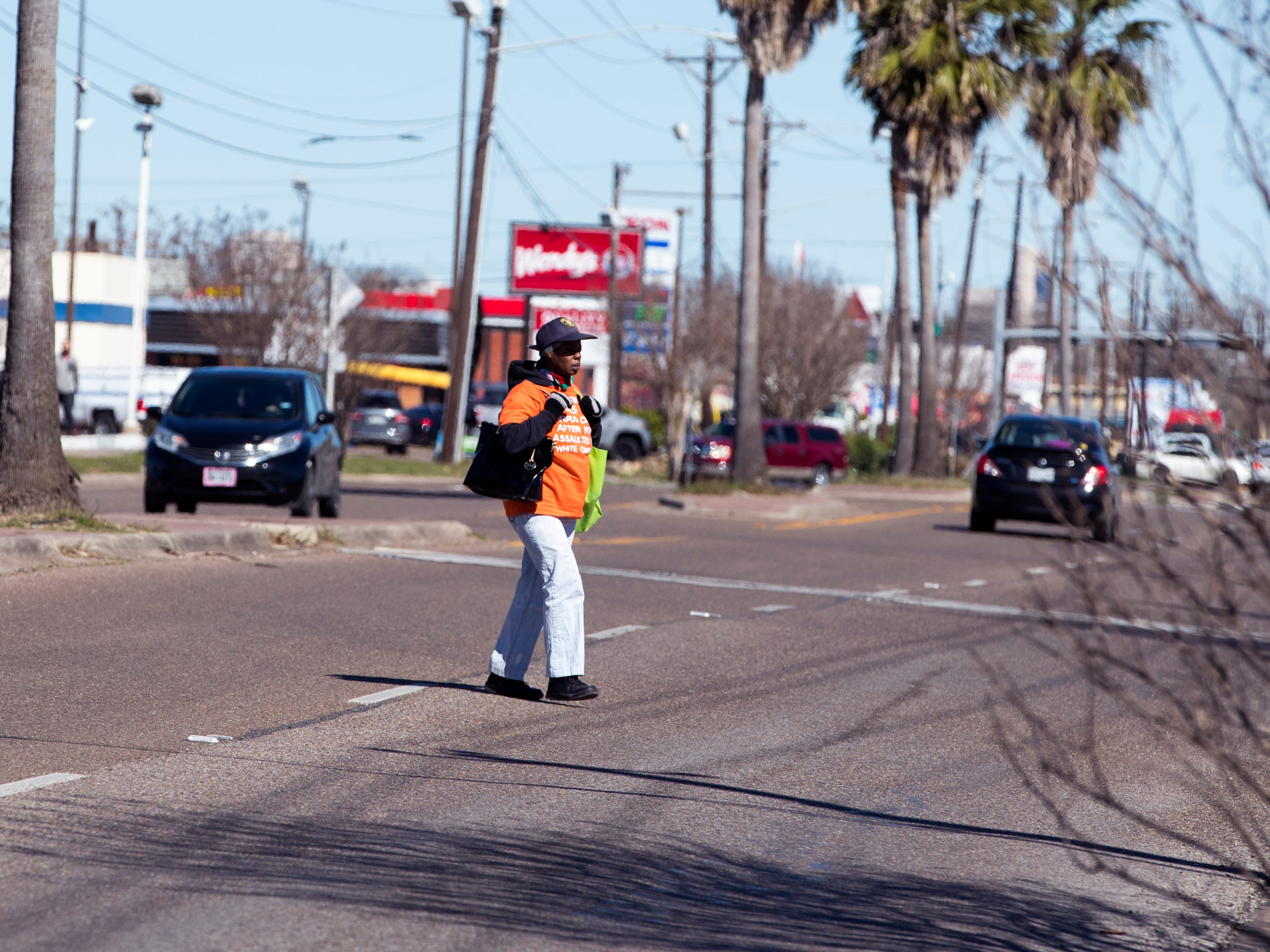 A man crosses in the middle of the street in the 4200 block of Ayers Street on Jan. 29, 2019. Statistics from the Corpus Christi Police Department show that a high number of auto-pedestrian accidents take place between the blocks of 4100 and 4900 Ayers Street.