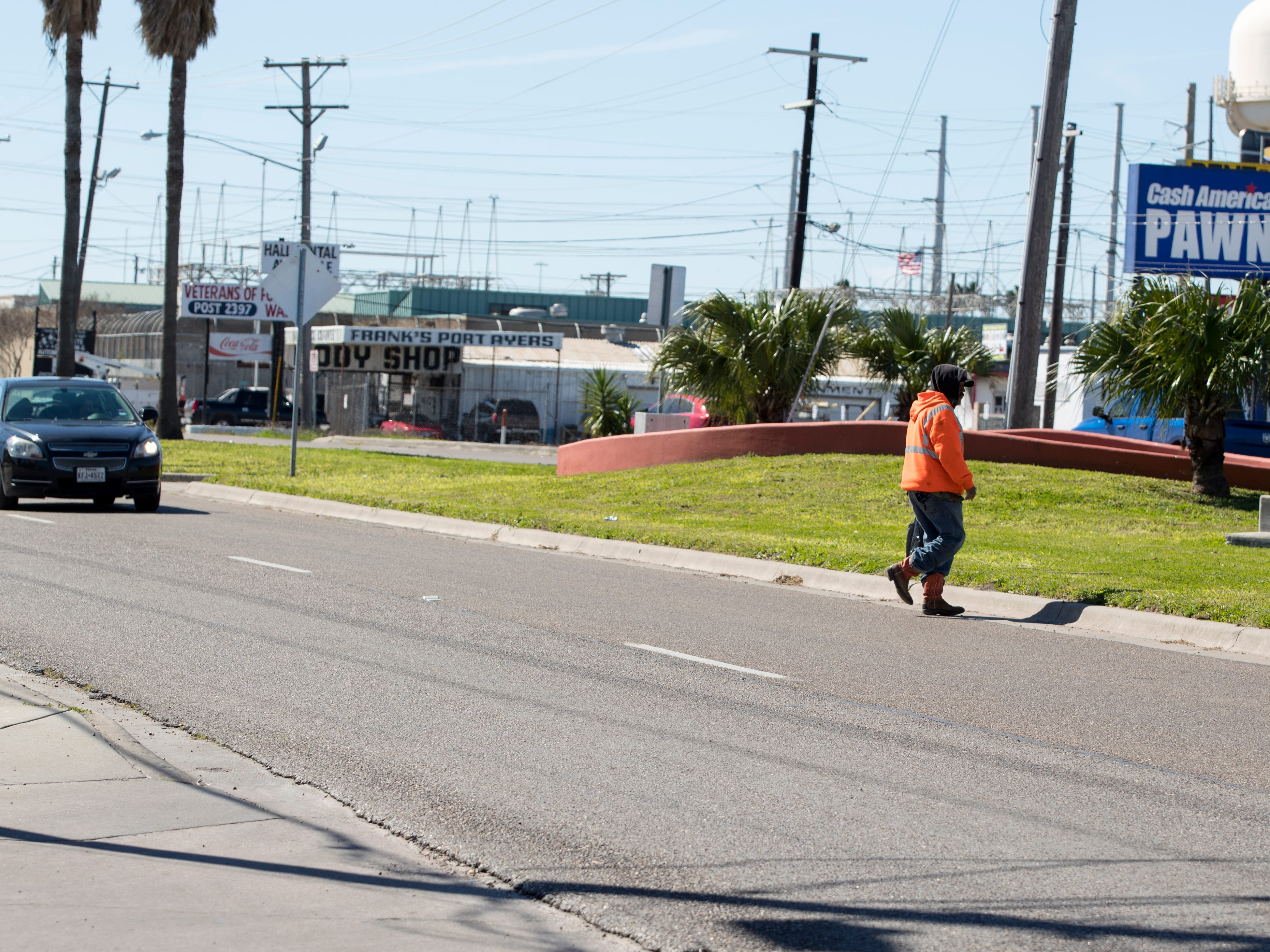 A man crosses in the middle of the street in the 4200 block of Ayers Street on January 29, 2019. Statistics from the Corpus Christi Police Department show that a high number of auto-pedestrian accidents take place between the blocks of 4100 to 4900 Ayers Street.