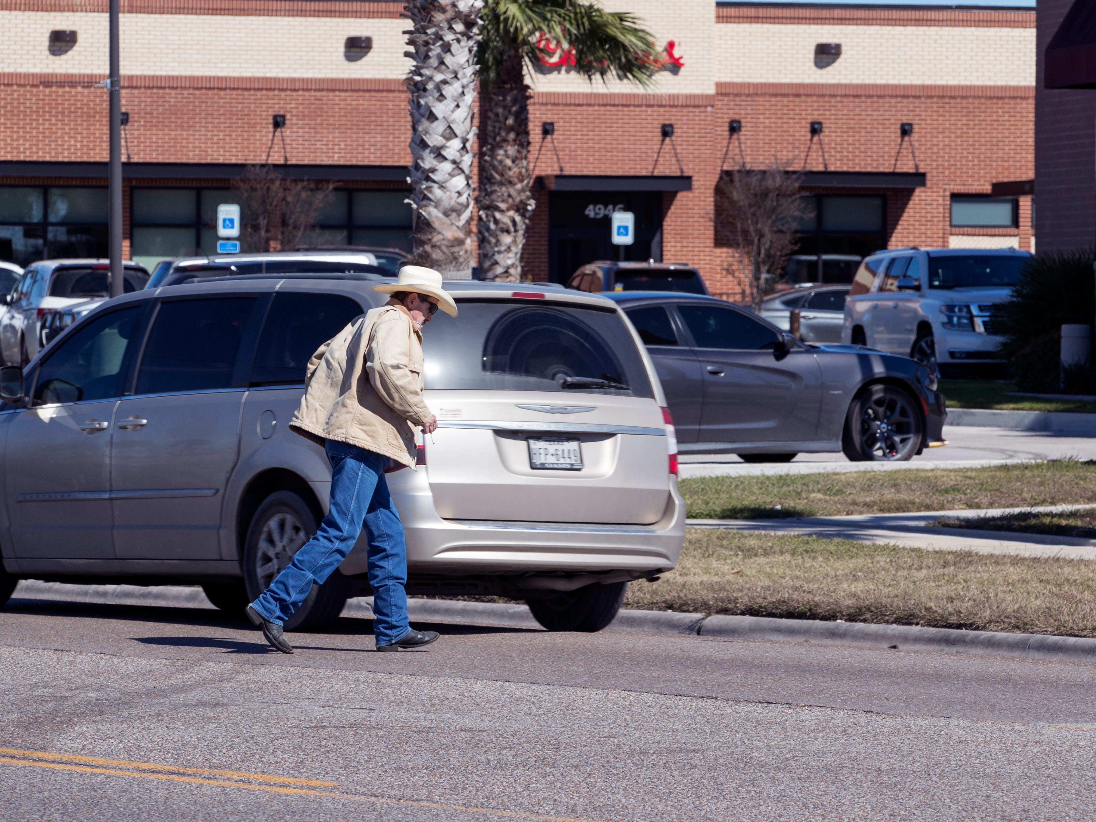 A man crosses in the middle of the street in the 5000 block of South Staples Street on Jan. 29, 2019. Statistics from the Corpus Christi Police Department show that a high number of auto-pedestrian accidents take place between the blocks of 5000 and 5800 South Staples Street.