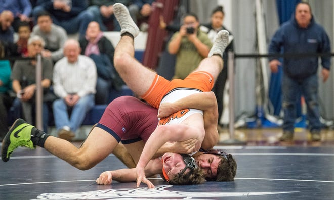 Eastern's Joe Del Palazzo controls Cherokee's Ian Manahan during the 145 lb. bout of Monday's wrestling match held at Eastern High School.  Del Palazzo won the bout, 8-7.