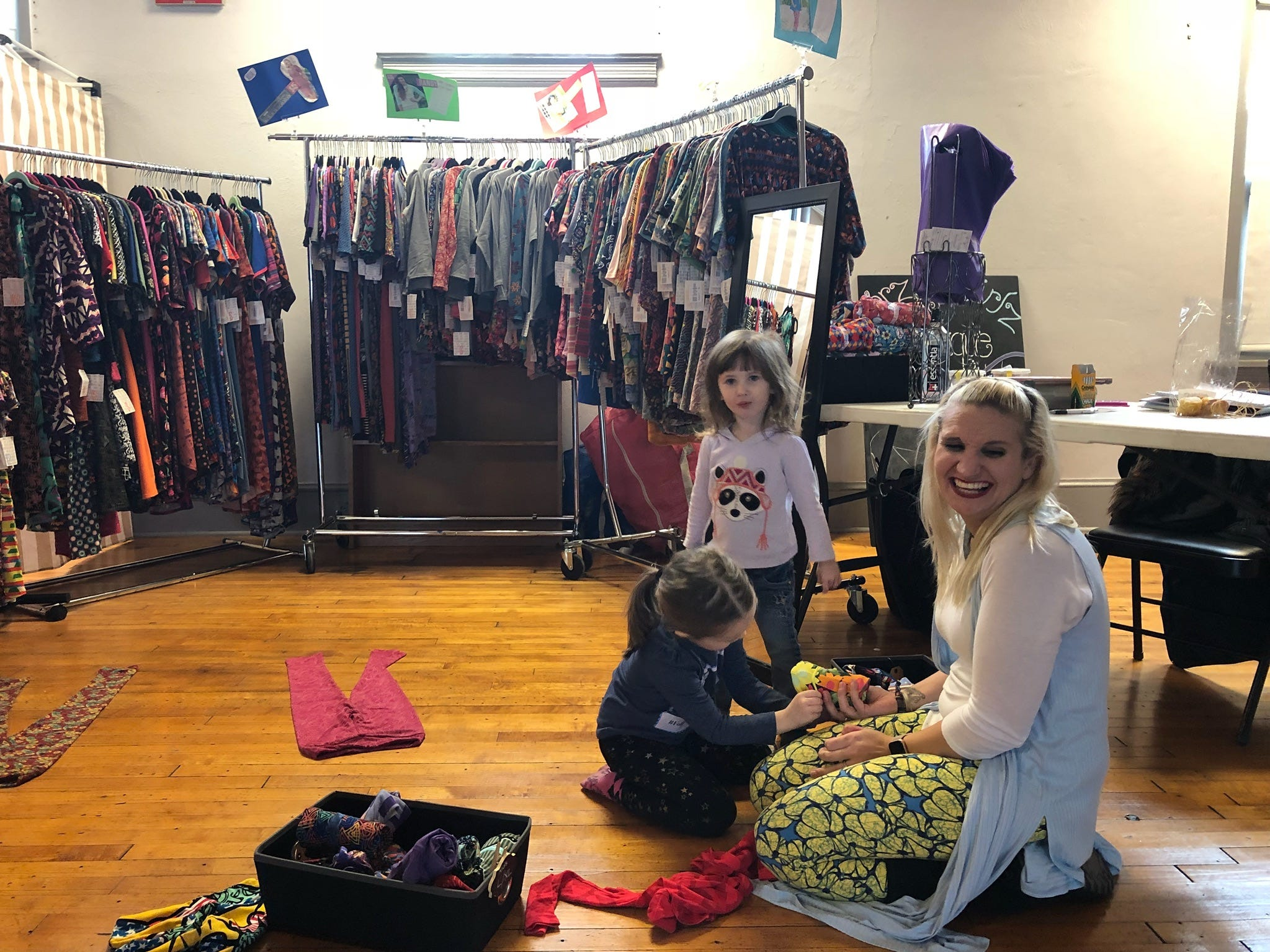 Samantha Wilbur of Jerzey Girlz Boutique hangs out with Grace Nairn (left), 4, and her sister Abbie, 3, at Ryan's Retail Pop-Up Shoppe in Merchantville.