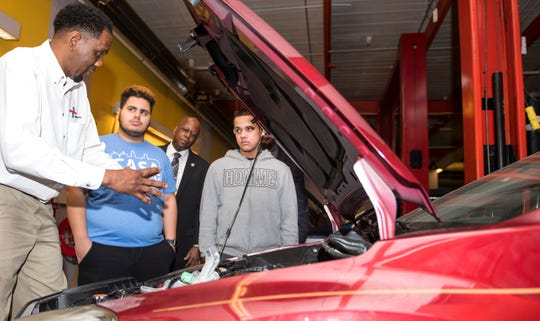 Respond, Inc. instructor Patrick Moore, left, goes over the parts of a car that are found under the hood with Mastery High School students Hector Lopez, center, and Danny Rivera, right, as NJ State Assemblyman Bill Spearman, background, looks on in the automotive technology training center of Respond Inc. in Camden, NJ, on Tuesday, January 29, 2019. Respond, Inc. has partnered with Mastery High School in North Camden to train 11th and 12th graders for careers as auto technicians and mechanics.