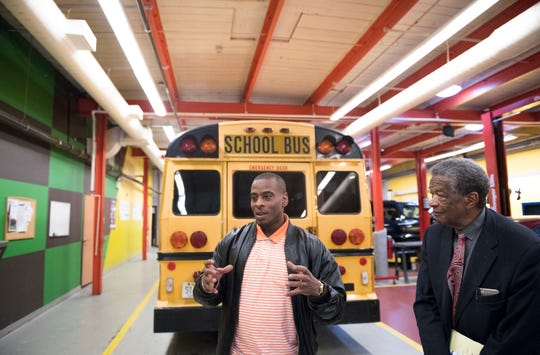 Randy Williams, left, a former student of Respond, Inc. stands next to Respond Inc. Executive Director Wilbert Mitchell as Williams visited the automotive technology training center of Respond Inc. in Camden, NJ, on Tuesday, January 29, 2019. Respond, Inc. has partnered with Mastery High School in North Camden to train 11th and 12th graders for careers as auto technicians and mechanics.