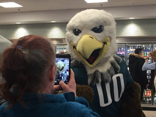 Dana Howe-Smith, a shopper from Cherry Hill, photographs Swoop during an event at a township Wawa Tuesday.