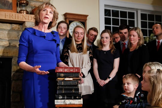 Ohio First Lady Fran DeWine explains the nine family bibles her husband Gov. Mike DeWine took his oath of office on during a private midnight ceremony at their Cedarville home on Jan. 14.