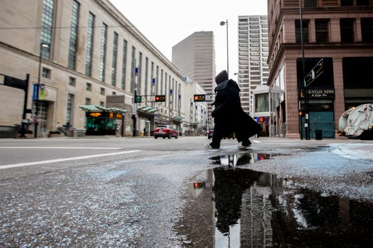 Pedestrians walk in downtown Cincinnati on Tuesday, Jan. 29, 2019. The National Weather Service at Lunken Field is reporting a current temperature of 18 degrees Fahrenheit and with a wind chill it feels like 3 degrees Fahrenheit.