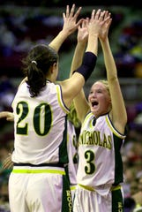 From left, McNicholas's Ashley Clark and Liz Flammer celebrate in the final minutes of the Division II state championship game against Canfield at the Jerome Schottenstein Center in Columbus March 2001.