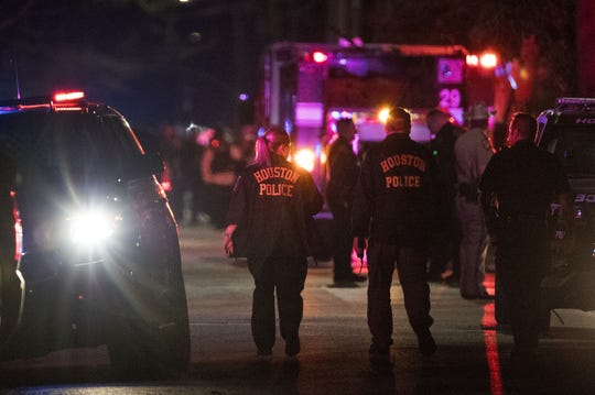 Police investigate the scene where several Houston Police officers were shot in Houston on Monday, Jan. 28, 2019. At least five Houston officers were injured in a shooting Monday in an incident involving a suspect and taken to a hospital, police said.
