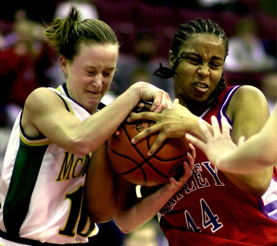 McNicholas's Kendra Hornschemeier and Bishop Hartley's DaVona Tucker fight for a loose ball during the 26th annual girls state basketball tournament semifinals at the Jerome Schottenstein Center in March 2001.