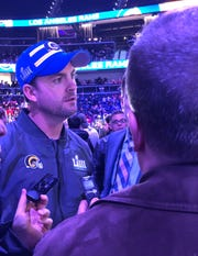 Zac Taylor chats with reporters during Opening Night in Atlanta.