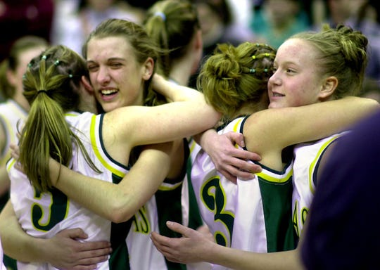 From left, McNicholas's Brittany Thomas, Jessica Breving, Liz Flammer, and Lauren Branson celebrate after winning of the Division II state championship game against Canfield Saturday afternoon at the Jerome Schottenstein Center in March 2001
