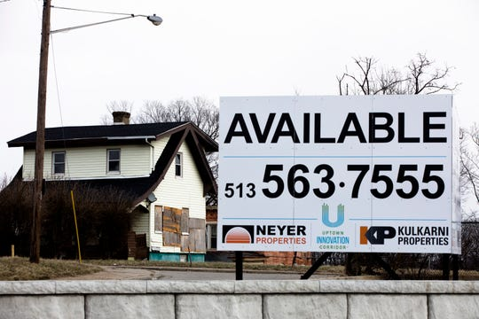 A sign advertises available real estate on the northeast corner of the intersection of Martin Luther King Drive and Reading Road in Avondale. The site is part of the Uptown Innovation Corridor project near Interstate 71.