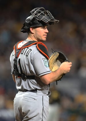Sep 7, 2018; Pittsburgh, PA, USA;  Miami Marlins catcher J.T. Realmuto (11) looks on from behind home plate against the Pittsburgh Pirates during the fifth inning at PNC Park. Mandatory Credit: Charles LeClaire-USA TODAY Sports