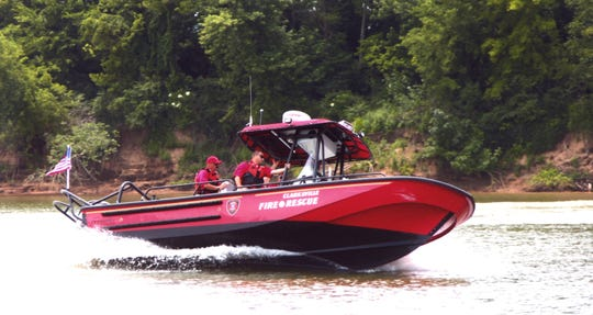 Members of Clarksville Fire Rescue's Marine Response Division operate the City's fire boat on the Cumberland River.