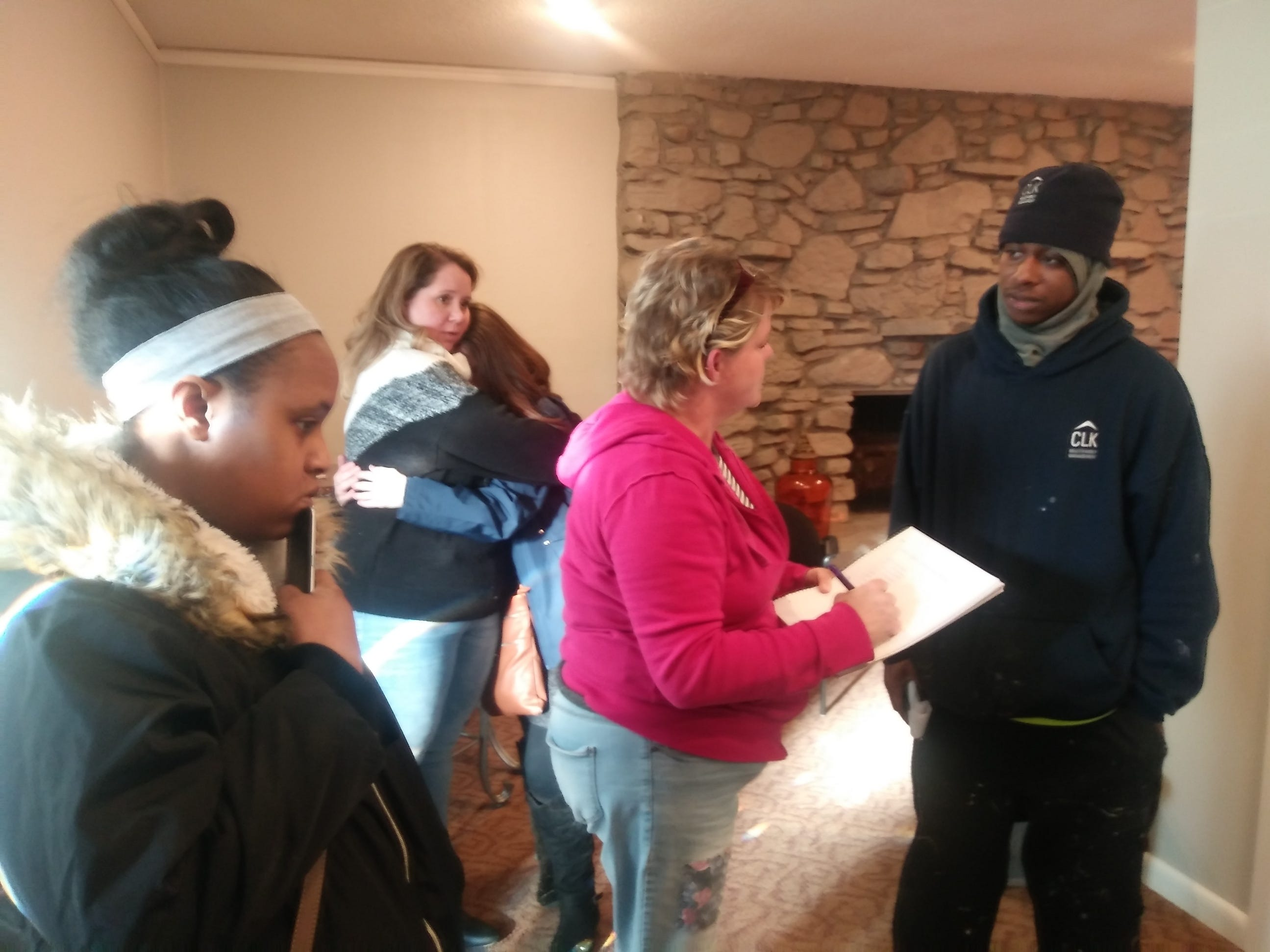 Amy James (in pink) helps residents with shelter following an apartment fire in Clarksville on Tuesday, Jan. 29, 2019.