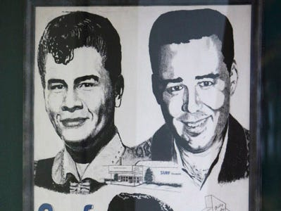 "A poster showing Buddy Holly, Ritchie Valens and J.P. ""The Big Bopper"" Richardson hangs on a wall in the Surf Ballrom, Friday, Jan. 9, 2009, in Clear Lake, Iowa."