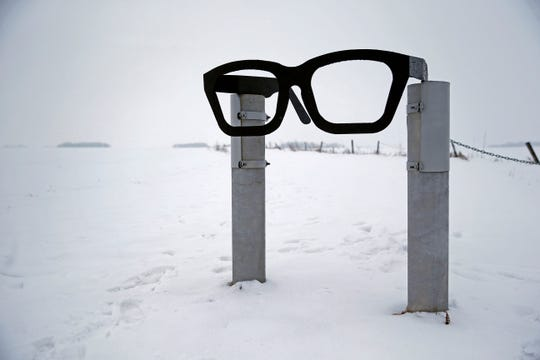 "A monument depicting musician Buddy Holly's glasses stands at the edge of a snowy field near the spot where the plane carrying Holly, Ritchie Valens and J.P. ""The Big Bopper"" Richardson crashed near Clear Lake, Iowa, Friday, Jan. 8, 2016. The three performers died in a plane crash Feb 3, 1959, after their final performance in Clear Lake."