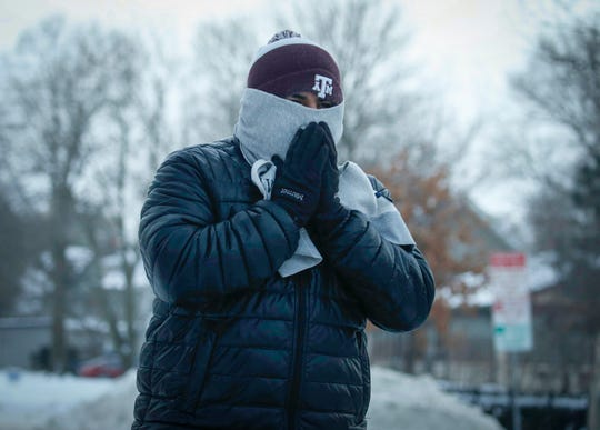 Javier Elias, a junior at Iowa State University, bundles up as he walks along Welch Ave. in Ames on Tuesday, Jan. 29, 2019, as temperatures dipped to below zero as a blast of cold air raked across the upper midwest.