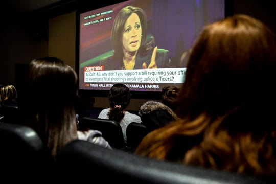People gather inside the Sussman Theater on the Drake University campus Monday, Jan. 28, 2019, in Des Moines to watch presidential hopeful Kamala Harris speak during a town-hall meeting, held on the Drake campus and aired on CNN. This is Harris' first visit to Iowa since announcing her presidential campaign.