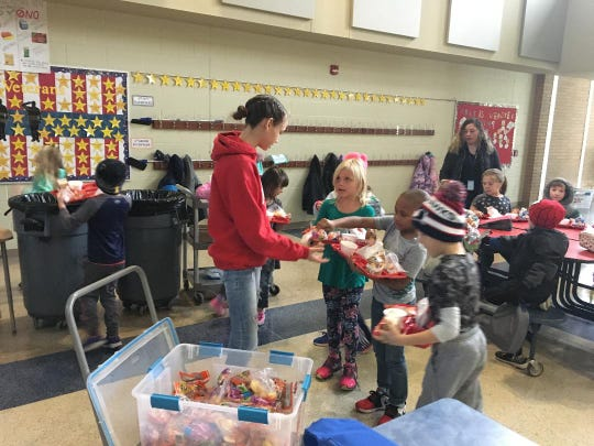Seventh-grader Taylor Mulligan, left, started a food rescue program at Urbandale's Webster Elementary. The program saves about 100 pounds of fresh food from being dumped into the trash each week. The packaged items and fresh produce are donated to the Urbandale Food Pantry.